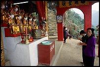 Praying at an outdoor temple. Perfume Pagoda near Hanoi, Vietnam