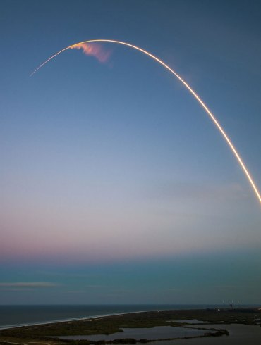 A rocket launching in a blue sky
