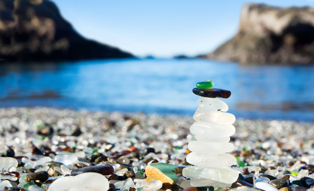 Photo of stacked sea glass at Glass Beach in Fort Bragg, California, courtesy Shutterstock.