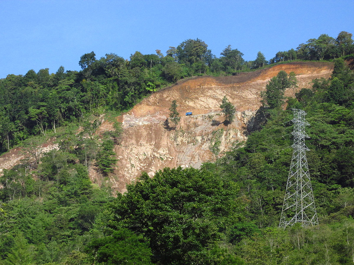 A landslide caused by road construction to access the site of a proposed hydropower project in Epapa. Photo by Noah Silber-Coats.