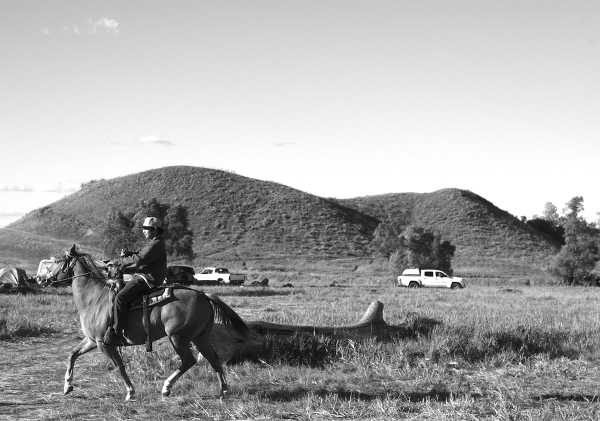 Sioux tribal member on horse