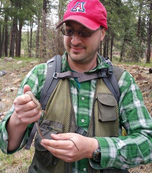 Brian holds a gartersnake