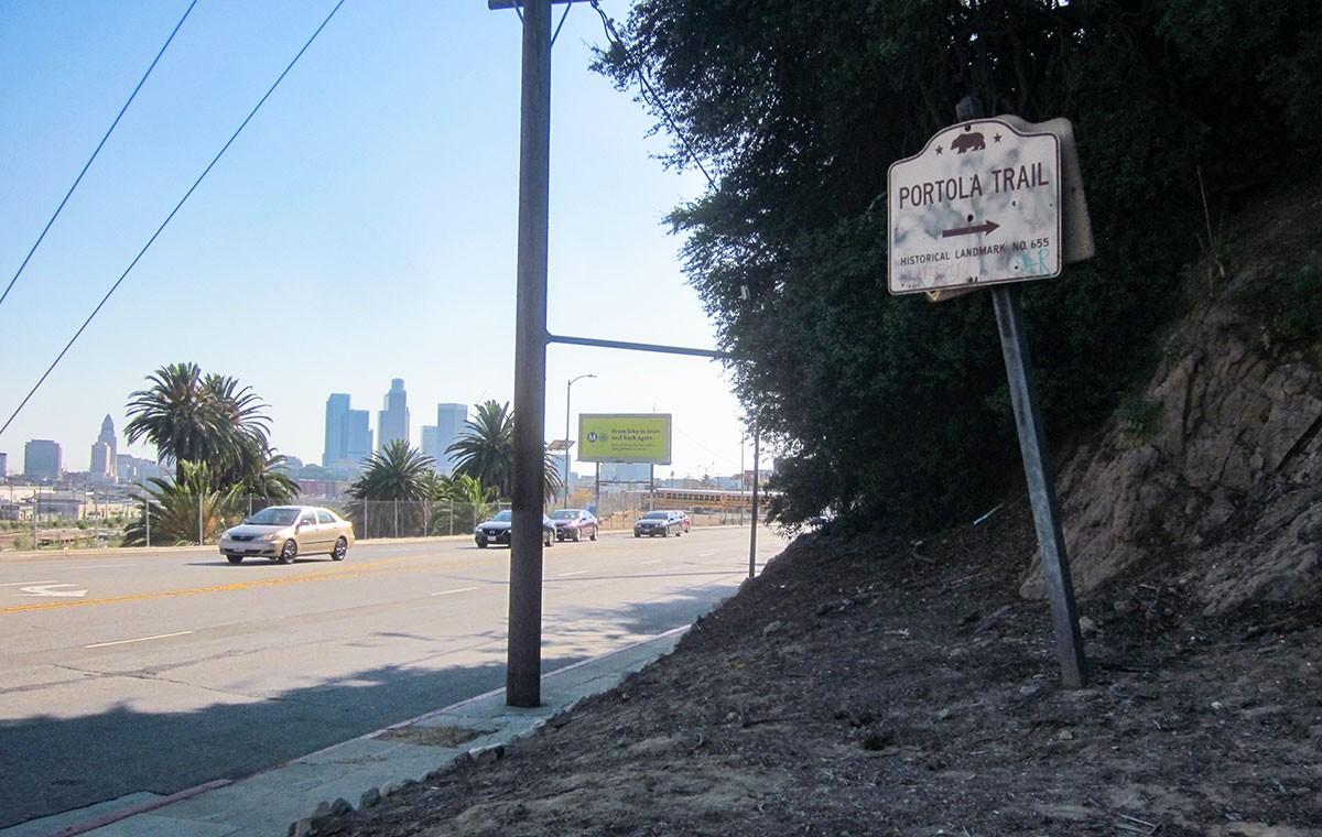 Portola Trail sign with downtown Los Angeles in the distance