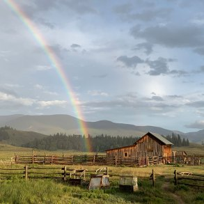 Rainbow ending in the barn on Pam Houston's Colorado ranch