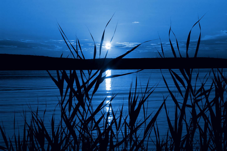 Moonlight on lake at night