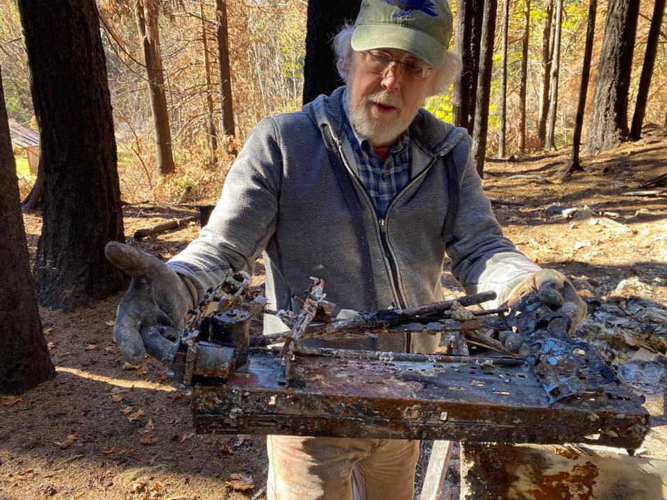 Barry Lopez with burned typewriter