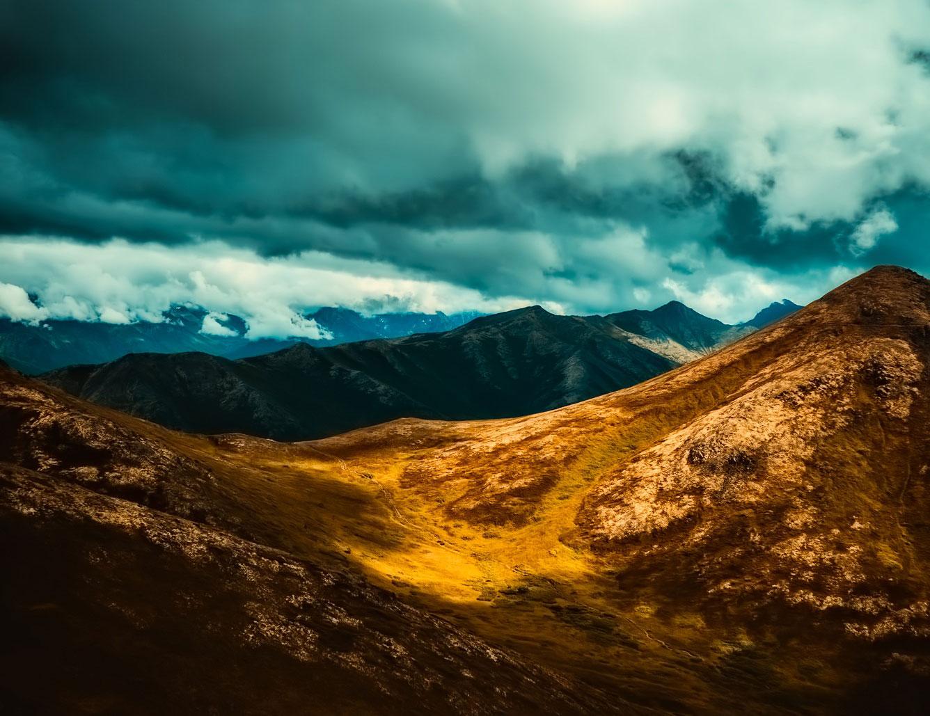 Dark clouds over Alaska mountains
