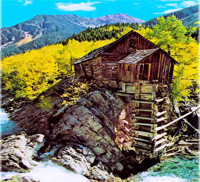 Rustic cabin on rock near river in Montana