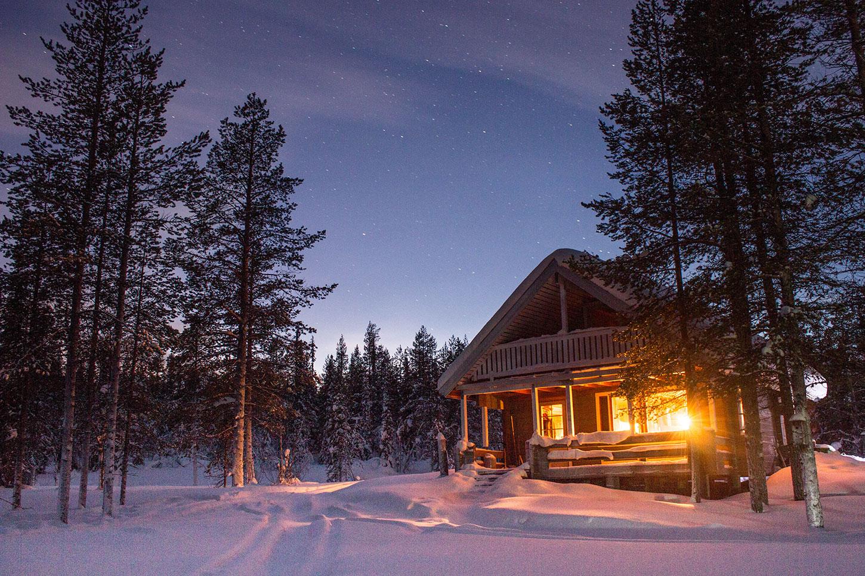 Lit cabin in snow