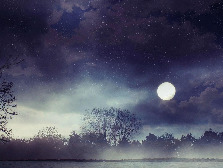 Full moon in misty landscape