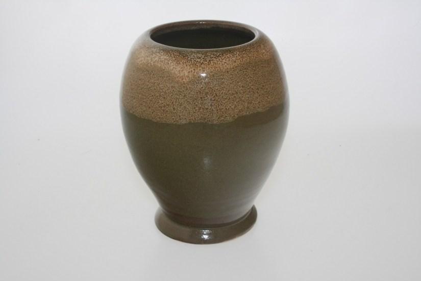 vase boule blanc sur vert nature