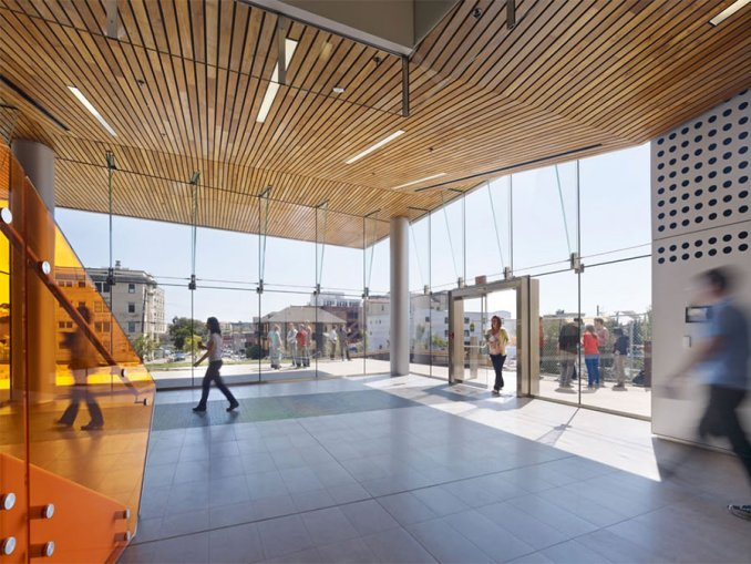 Reclaimed teak wood used for ceiling at Energy Bioscience Building wood ceiling flows uninterrupted from interior to exterior