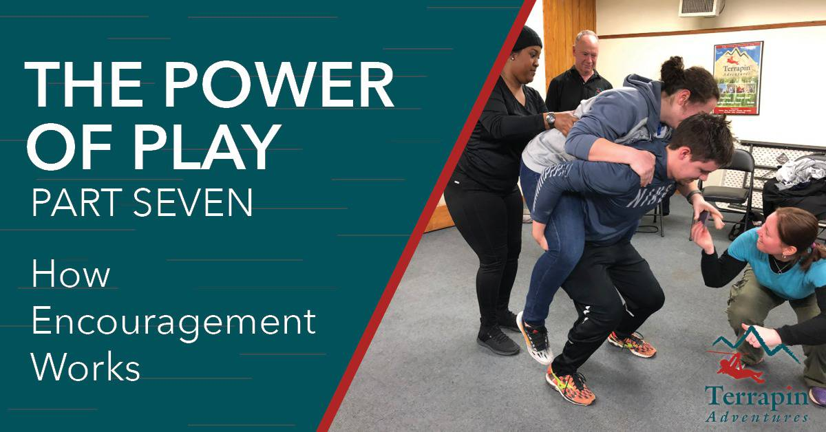 "Blog header reads ""The Power of Play Part Seven: How Encouragement Works."" Pictured is a woman riding on a man's shoulders as two people assist."