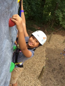 Girl Climbing Rock Wall