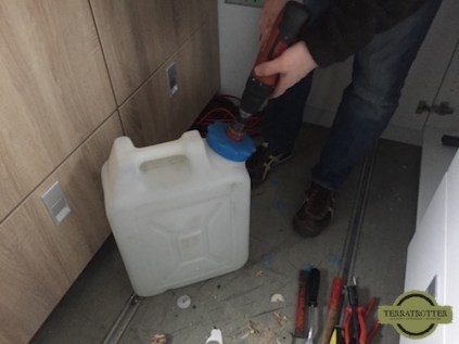 Drilling hole in cap of water canister