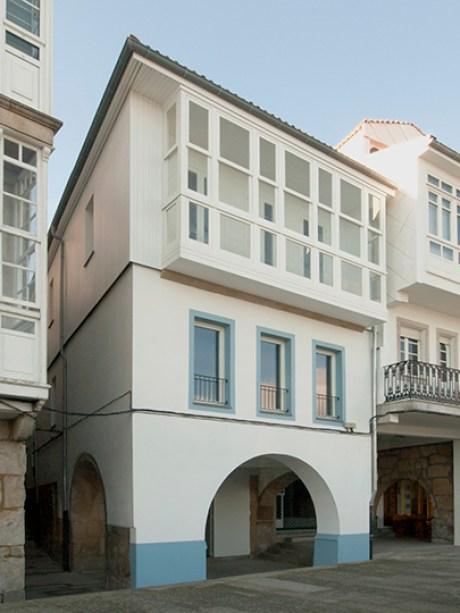 fachada casa de interiorismo rústico en muros