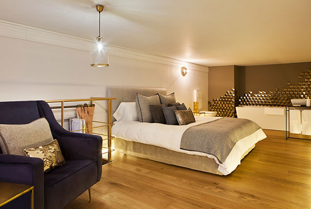 decoradores de interiores.Dormitorio en loft de Elisabeth Cueva
