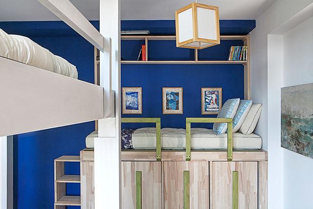 decoradores de interiores.Dormitorio en loft de Guillermo de Juan