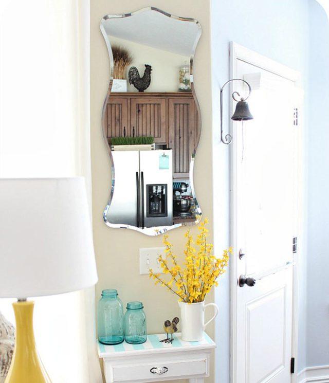 Decoracion con espejo del hall de una casa