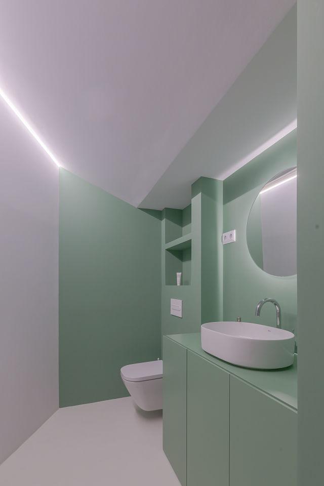 Baño de diseño en color verde