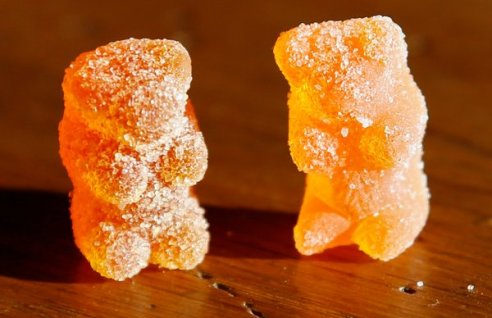 A marijuana-laced gummy bear, left, and a regular one look identical. (Credit: Rick Wilking/Reuters)