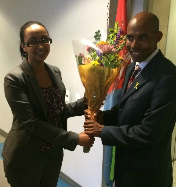Staff member of the Eritrean Permanent representative welcoming Meb Kiflezghi to the Mission