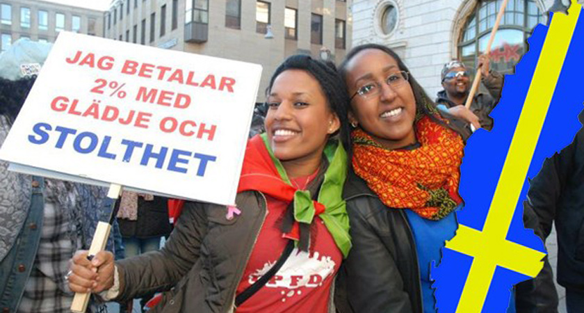 "Swedish-Eritrean citizens holding a sign that reads ""I pay 2% with joy and Pride"""