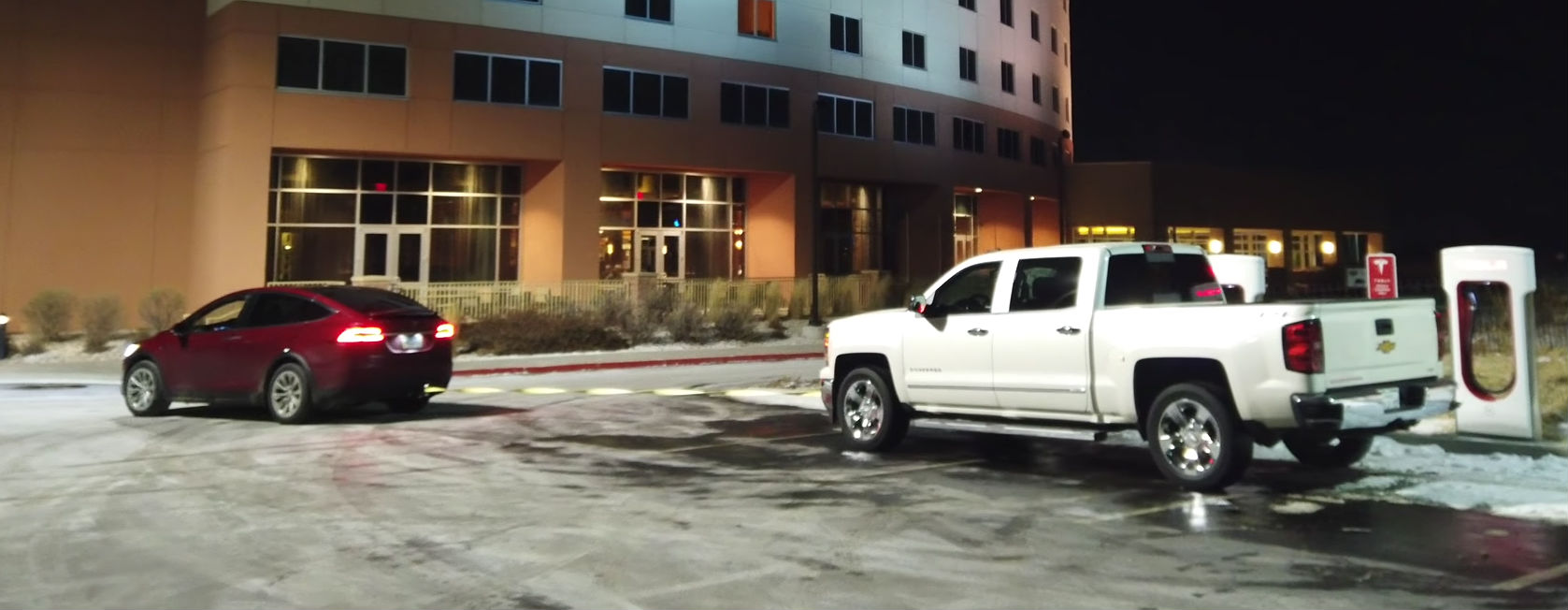 Tesla Model X Easily Tows Chevy Silverado 1500 From