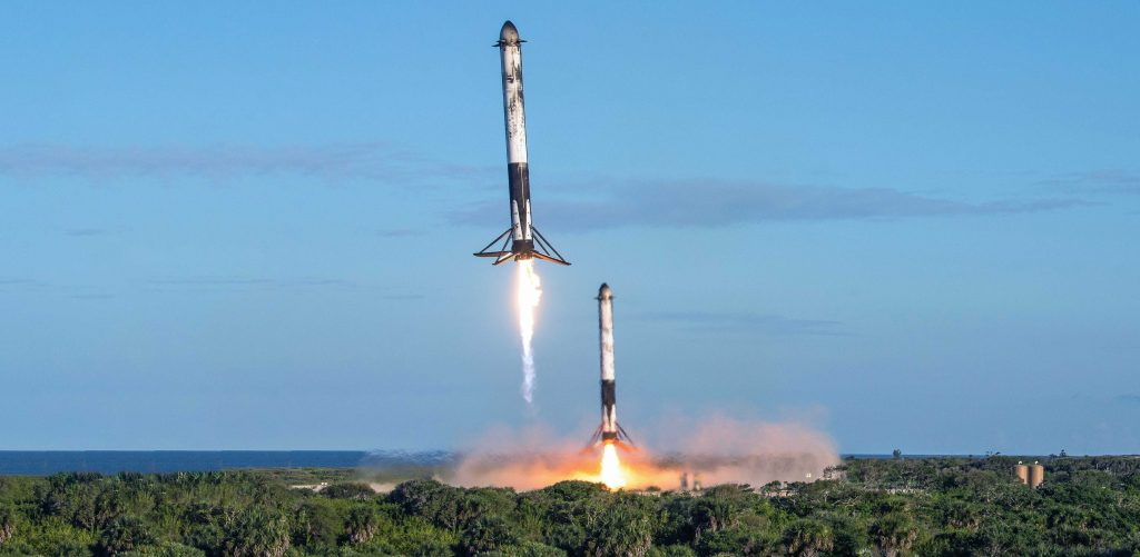 USAF photographer James Rainier's remote camera captured this spectacular view of Falcon Heavy Block 5 side boosters B1052 and B1053 returning to SpaceX Landing Zones 1 and 2. (USAF - James Rainier)