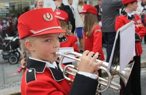 a girl playing a trumpet
