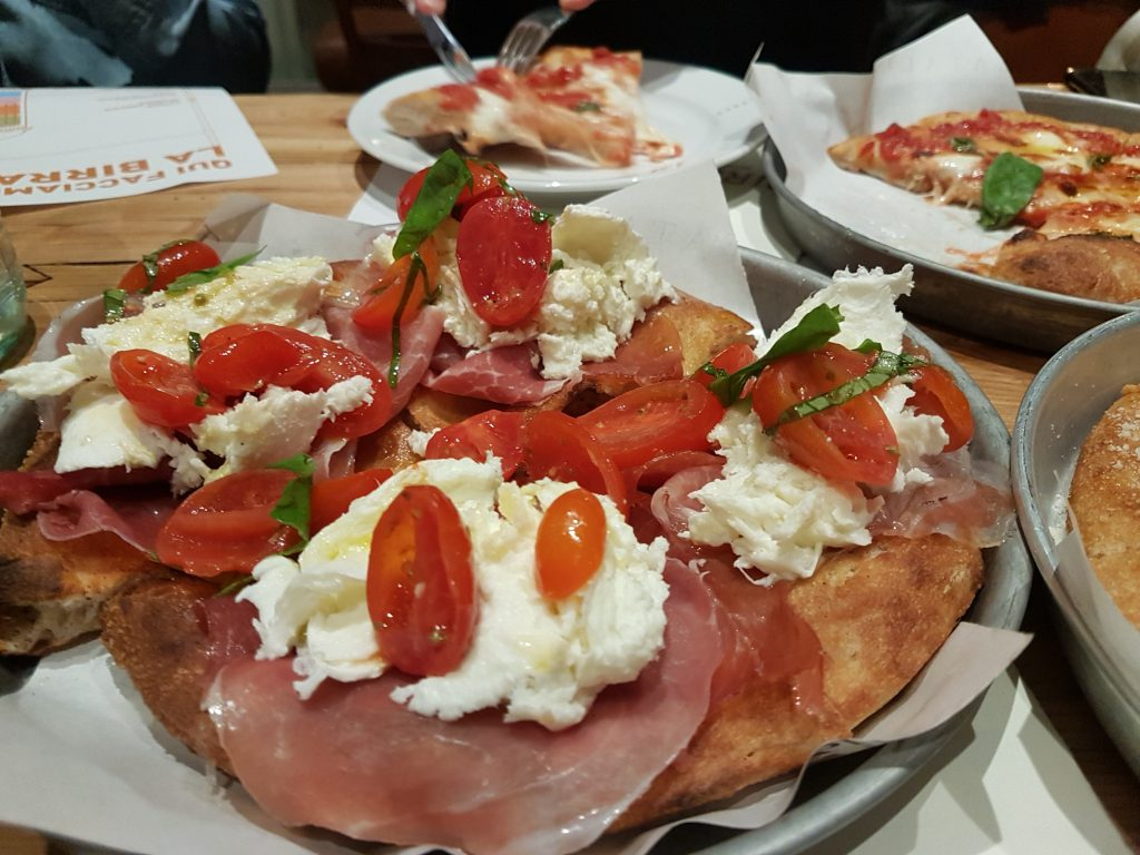 Eataly Rome's Birreria at Eataly Ostiense serves home-brewed pints, a rotating tap list of guest ales, plus tempting pan-baked pizzas and hot-dogs
