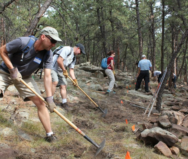 Imba And Volunteers Work On A Rocky Section Of Trail Mostly To Improve Flow And Drainage But Also The Organization Gets Criticized For Grooming Out Techy
