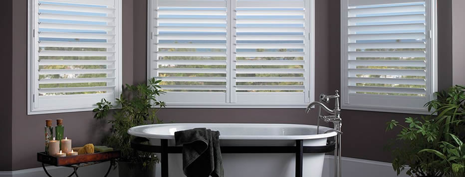plantation shutters in bathroom with hidden tilt bar
