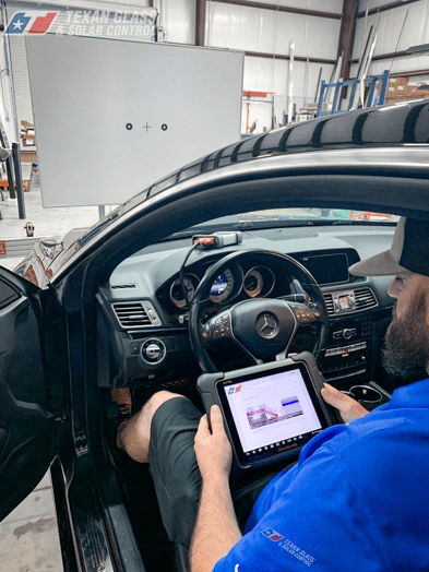 man calibrating adas calibration systems on mercedes the woodlands tx