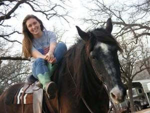 Rachel Hitt poses with her horse and other half of the Texan Rider mascot duo, Kokomo. (Photo courtesy of Rachel Hitt)
