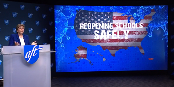 """Randi Weingarten at the AFT national convention. Graphic behind her reads """"Reopening Schools Safely."""""""