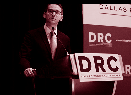 Texas Education Commissioner Mike Morath speaking at a lectern.