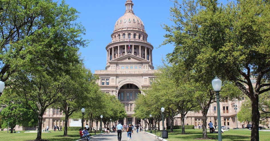 Tree-lined walkway leading to the Texas Capitol building
