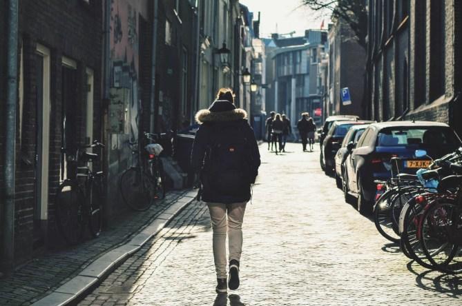 man alone walking down alley