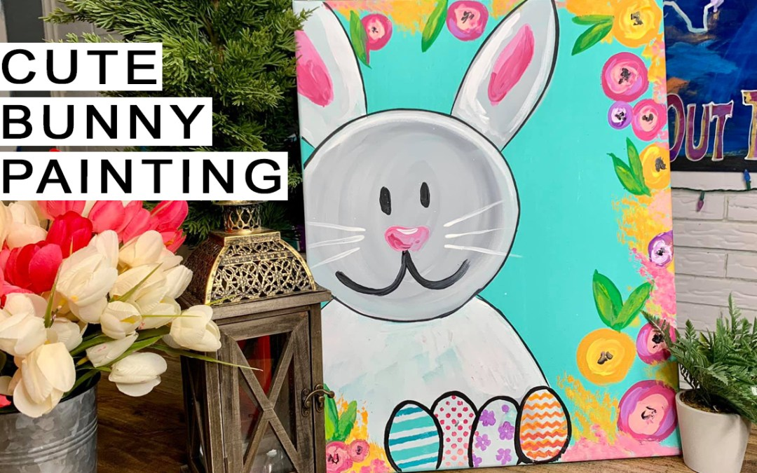 Cute bunny painting with easter eggs and flowers