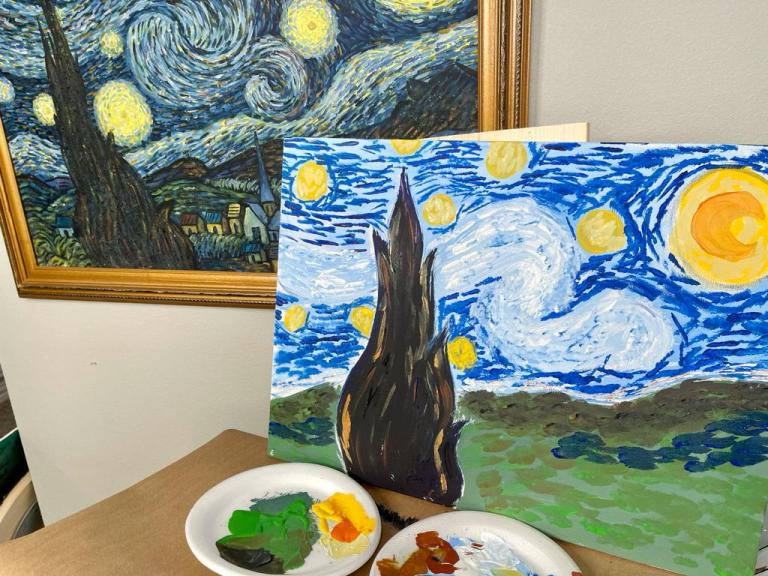 Starry Night Painting Reproduction In Progress next to Starry Night by Van Gogh