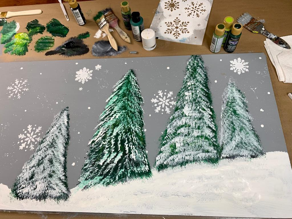 painting of winter scene backdrop for mantel with paint supplies