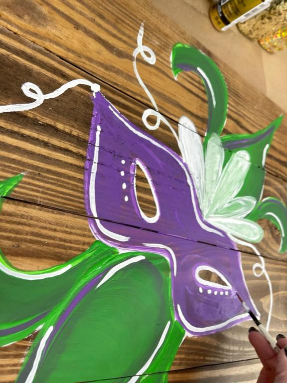 Painting on wood of Mardi Gras mask and Fleur Di Lis