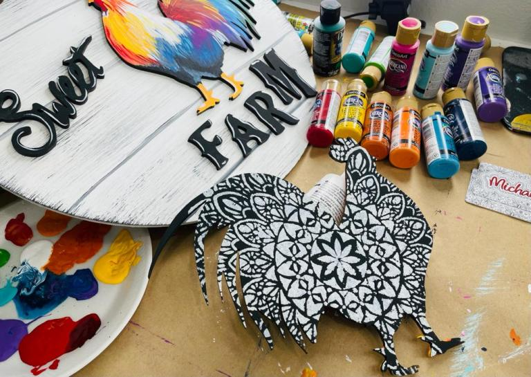 wood door hanger with words farm sweet farm with brightly painted rooster and black & white rooster