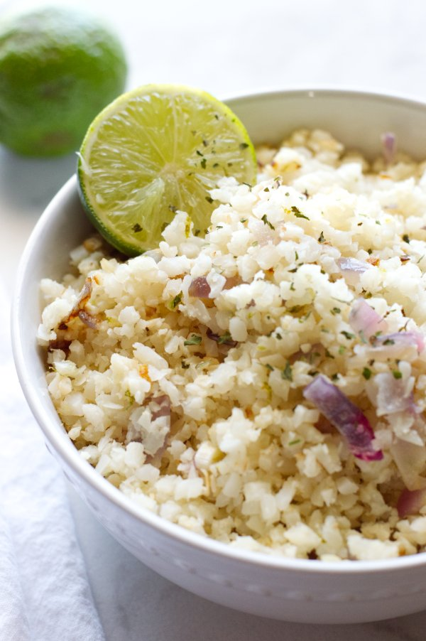 Bowl of cauliflower rice with a lime