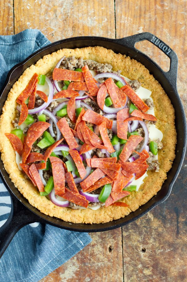 keto pizzza crust in cast iron with toppings