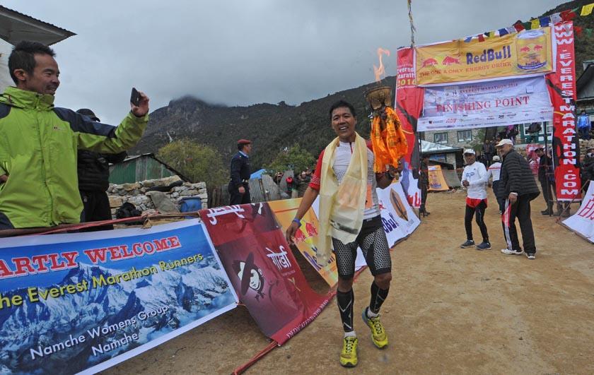Bed Bahadur Sunuwar of Nepal Army crosses the finishing point of the Full Marathon Open at Namche Bazaar. Photo: Tenzing Hillary Everest Marathon