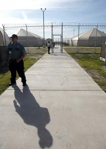 Security guards patrol the area of the Willacy County Detention Center for Immigrant detainees in Raymondville, Texas.