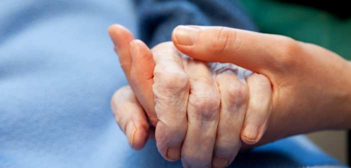Young person holding old person's hand