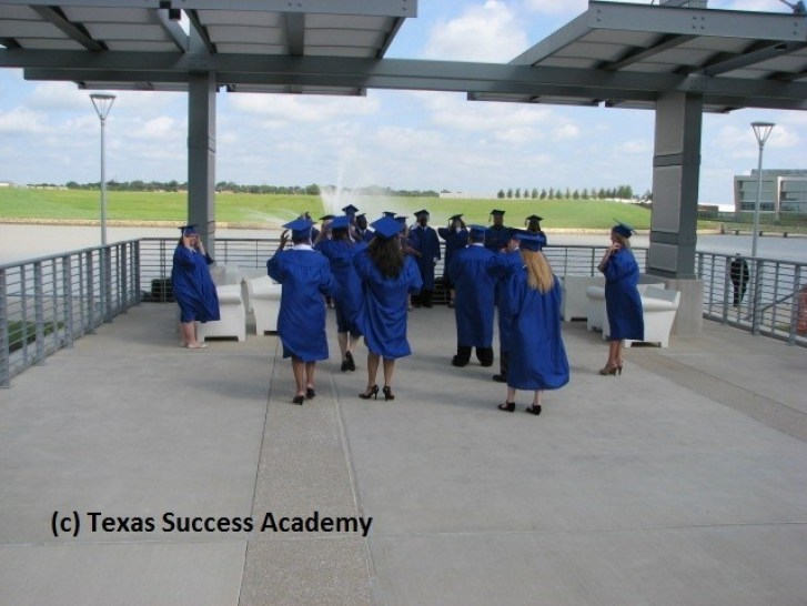 Texas Success Academy Studetns walking to take their class photo